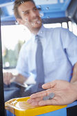 Close Up Of Hand Giving Driver Fare For Bus Journey — Stock Photo