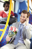 Man Going To Date On Bus Holding Bunch Of Flowers — Stock Photo