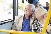 Senior Couple Enjoying Journey On Bus — Stok fotoğraf