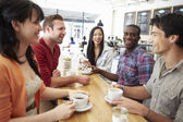 Group Of Friends Meeting In Coffee Shop — Stock Photo