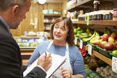 Bank Manager Meeting With Female Owner Of Farm Shop — Stock Photo