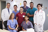 Portrait Of Medical Team At Nurses Station — Stock Photo