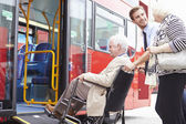 Driver Helping Senior Couple Board Bus Via Wheelchair Ramp — Stock Photo