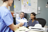 Medical Staff Meeting At Nurses Station — Stock Photo