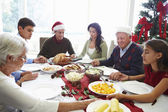 Multi Generation Family Praying Before Christmas Meal — Stock Photo