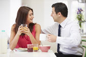 Couple Having Breakfast Before Husband Goes To Work — Stock Photo