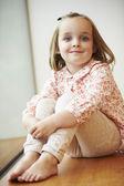 Portrait Of Young Girl Sitting On Floor — Stock Photo