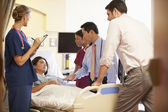 Medical Team Meeting Around Female Patient — Stock Photo