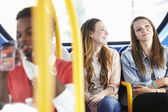 Two Young Women On Bus Journey Together — Stock Photo