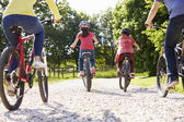 Rear View Of Hispanic Family On Cycle Ride In Countryside — Stock Photo