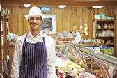 Male Sales Assistant In Delicatessen — Stock Photo