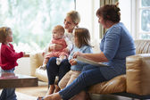 Health Visitor Talking To Mother With Young Children — Stock Photo