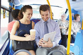 Businessman And Woman Using Digital Tablet On Bus — Foto de Stock