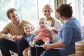 Health Visitor Talking To Family With Young Baby — Stock Photo