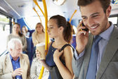 Passengers Standing On Busy Commuter Bus — Stockfoto