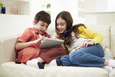 Children Playing With Digital Tablet And MP3 Player — Stockfoto