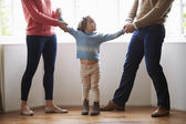 Two Parents Fighting Over Child In Divorce Concept — Стоковое фото