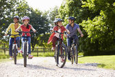 Hispanic Family On Cycle Ride In Countryside — Stock Photo