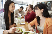 Two Female Friends Friends Meeting For Lunch In Coffee Shop — Stock Photo