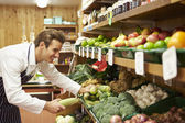 Male Sales Assistant At Vegetable Counter Of Farm Shop — Stock Photo