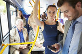 Passengers Standing On Busy Commuter Bus — Stock Photo