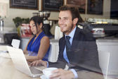 Businessman Using Laptop In Coffee Shop — Stockfoto