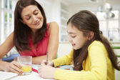 Mother Helping Daughter With Homework — Stock Photo