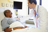 Doctor Talking To Senior Woman In Hospital Room — Stock Photo