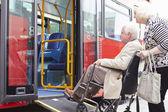 Senior Couple Boarding Bus Using Wheelchair Access Ramp — Stock Photo
