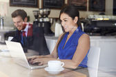 Businesswoman Using Laptop In Coffee Shop — Stock Photo