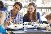 Family Enjoying Meal At Outdoor Restaurant — Stock Photo