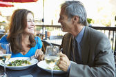 Mature Couple Enjoying Meal At Outdoor Restaurant — Foto Stock