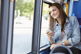 Teenage Girl Wearing Earphones Listening To Music On Bus — Stock fotografie