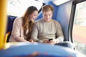Teenage Couple Reading Text Message On Bus — Stock Photo