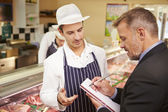 Bank Manager Meeting With Owner Of Butchers Shop — Stock Photo