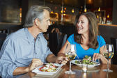 Mature Couple Enjoying Meal At Outdoor Restaurant — 图库照片