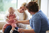 Health Visitor Talking To Mother With Young Baby — Stock Photo