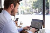 Businessman Using Laptop In Coffee Shop — Zdjęcie stockowe