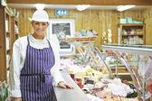 Female Sales Assistant In Delicatessen — Stock Photo