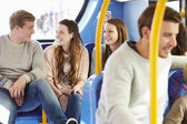 Group Of Young People On Bus Journey Together — Stock Photo