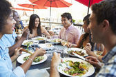 Group Of Friends Enjoying Meal At Outdoor Restaurant — Foto de Stock