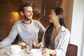 Couple Meeting In Busy Cafe — Stock Photo