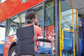 Disabled Woman In Wheelchair Boarding Bus — Stockfoto