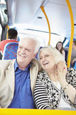 Senior Couple Enjoying Journey On Bus — Stok fotoğraf