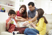Family Playing With Digital Tablet And MP3 Player — Stock Photo