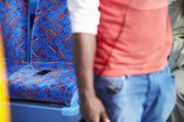Passenger Leaving Mobile Phone On Seat Of Bus — Stock Photo