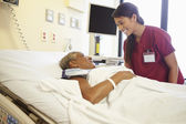 Nurse Talking To Senior Woman In Hospital Room — Stock Photo