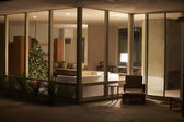 Lounge Decorated For Christmas Viewed From Outside — Foto de Stock