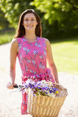 Attractive Woman Pushing Bike Along Country Lane — Foto Stock