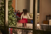 Family Celebrating Christmas At Home Viewed From Outside — Stock Photo
